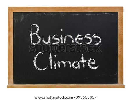 Business Climate written in white chalk on a black chalkboard isolated on white