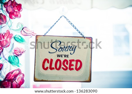 Business close with closed sign - stock photo
