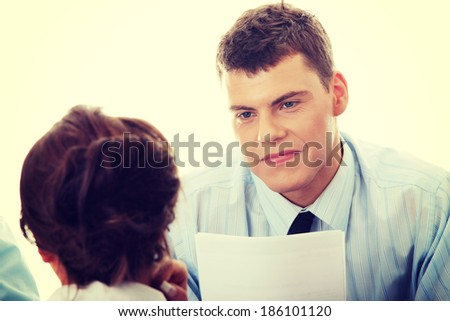 Business coaching concept. Young woman being interviewed for a job.