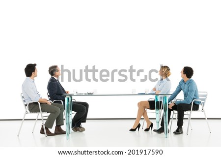 Business Colleague Looking At Projection Screen - stock photo
