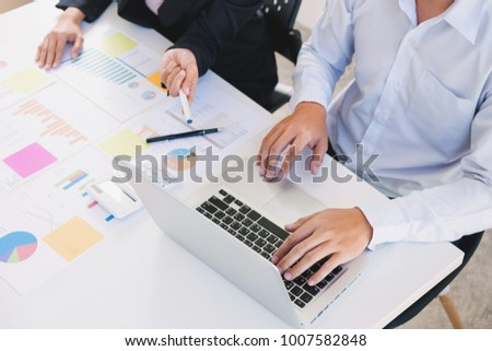 Business colleagues analysis data document with accountant