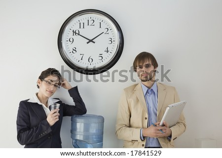 Business colleagues at water cooler