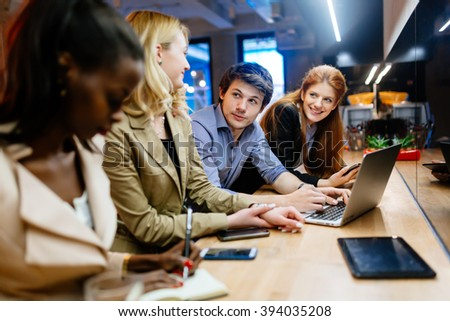 Business colleagues bonding in pub after work - stock photo