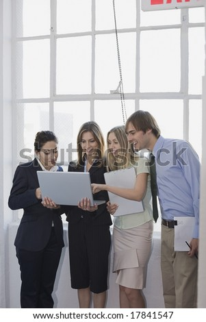 Business colleagues conversing near window - stock photo