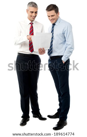 Business colleagues discussing a project reports - stock photo