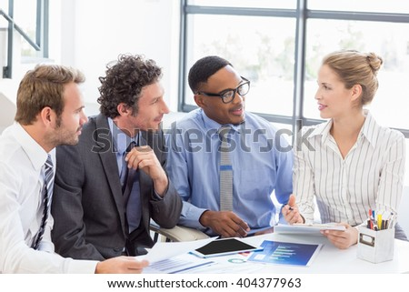 Business colleagues discussing a report in office