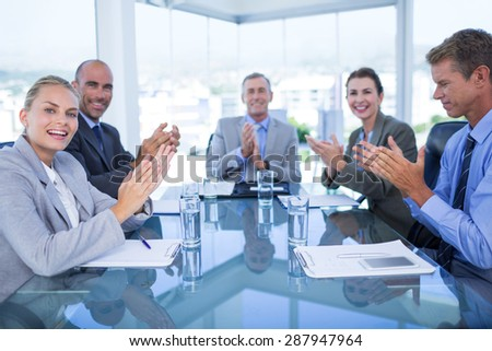 Business colleagues discussing about work in the office - stock photo