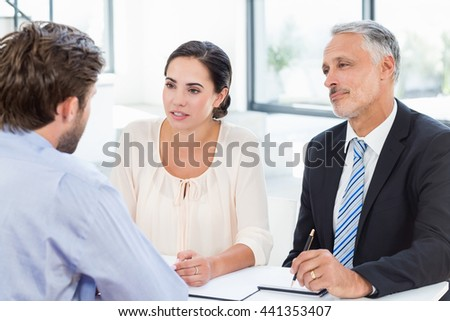 Business colleagues discussing during meeting in office