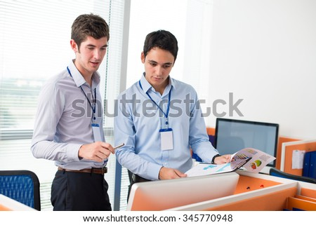 Business colleagues discussing financial document