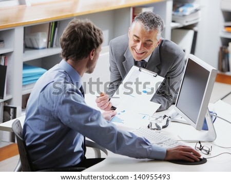 Business colleagues discussing together in an office