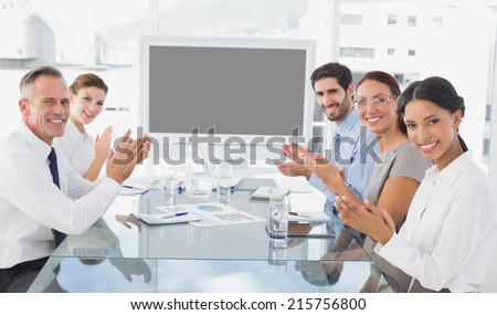 Business colleagues giving applause in a meeting - stock photo
