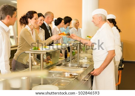 Business colleagues in cafeteria cook serve fresh healthy food meals