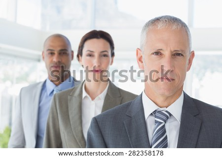 Business colleagues looking at camera in the office