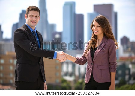 Business colleagues meeting and greeting shaking hands partnership success - stock photo