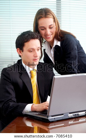 business colleagues on a laptop computer at the office