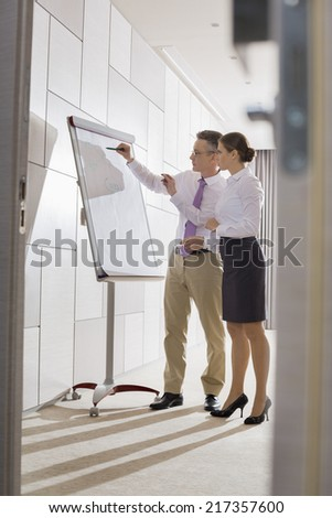 Business colleagues preparing for presentation in office - stock photo