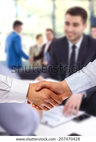 Business colleagues sitting at a table - stock photo