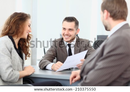 Business colleagues sitting at a table during a meeting  - stock photo