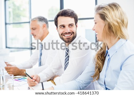 Business colleagues talking in a meeting at office - stock photo