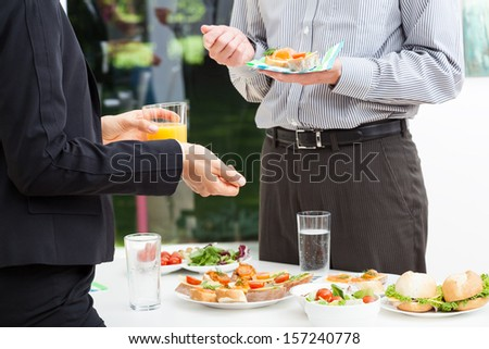Business colleagues talks during lunch, outdoor - stock photo