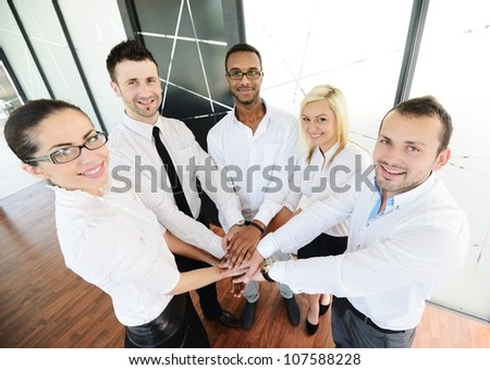 business colleagues with their hands stacked together - stock photo