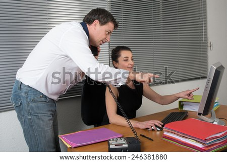 Business Colleagues Working At Desk
