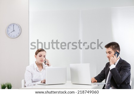 Business colleagues working on a laptop