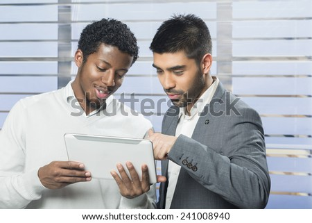 Business colleagues working together as a team - stock photo