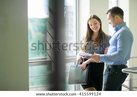 Business colleagues working together in the office - stock photo