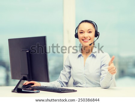 business, communication and call center concept - friendly female helpline operator with headphones showing thumbs up - stock photo