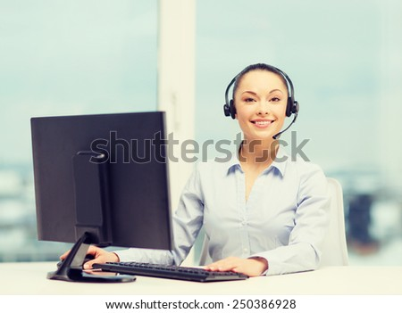 business, communication and call center concept - friendly female helpline operator with headphones - stock photo