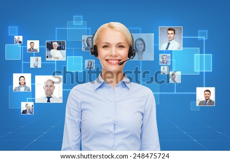 business, communication, cooperation and people concept - happy female helpline operator with headset over blue background and icons of contacts or customers - stock photo