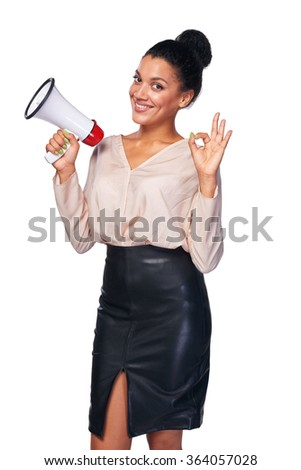 Business, communication, information concept. Confident smiling mixed race caucasian - african american business woman holding loudspeaker and gesturing OK hand sign - stock photo