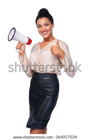 Business, communication, information concept. Confident smiling mixed race caucasian - african american business woman holding loudspeaker and gesturing thumb up sign