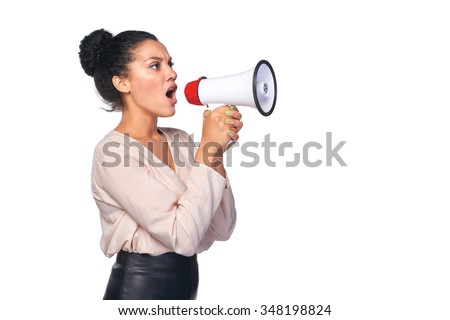 Business, communication, information concept. Side view of angry serious mixed race caucasian - african american business woman screaming into loudspeaker