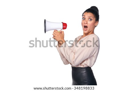 Business, communication, information concept. Surprised mixed race caucasian - african american business woman holding loudspeaker and looking with amazement at the camera