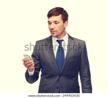 business, communication, modern technology and office concept - buisnessman with smartphone - stock photo