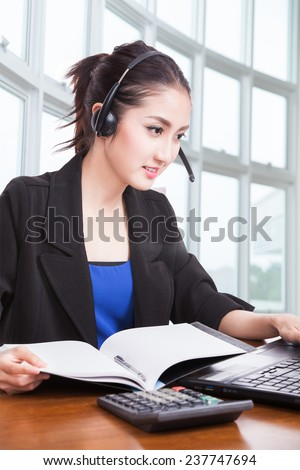 business, communication, technology and call center concept - friendly asian female helpline operator with headphones - stock photo