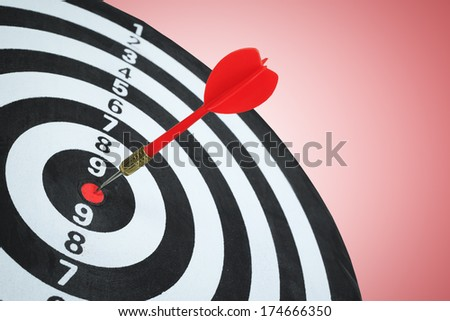 Business competition target concept and darts board - stock photo