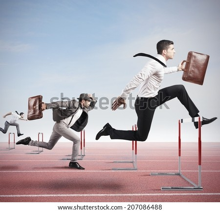 Business competition with jumping businessman over obstacle - stock photo