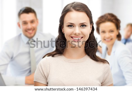 business concept - attractive young businesswoman in office - stock photo