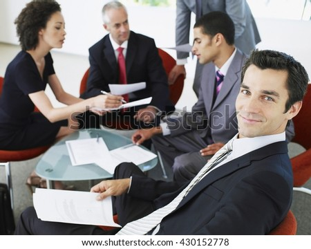 Business concept - Business people having business meeting in office - stock photo