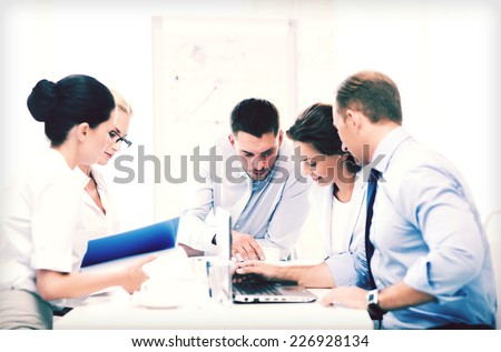 business concept - business team having meeting in office - stock photo