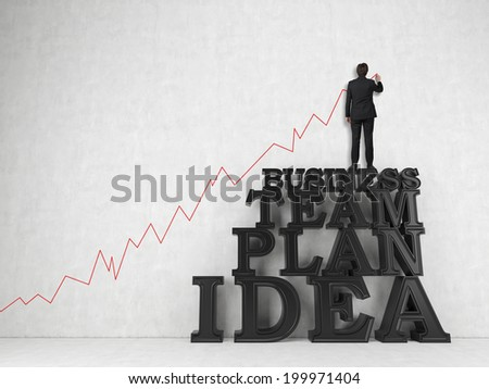 Business concept: BUSINESS, TEAM, PLAN, IDEA - words in 3d and a young professional businessman drawing a line red graph - stock photo