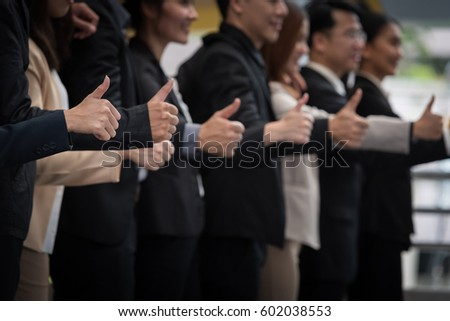 business concept - business team showing thumbs up
