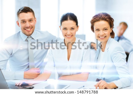 business concept - business team working with tablet pc and laptop in office
