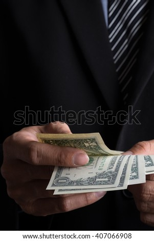 business concept, Businessman counting money stack of dollars in hands