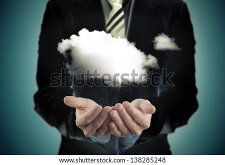 Business concept.Businessman holding a rainy cloud - stock photo