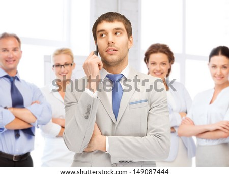 business concept - businessman talking on the phone in office