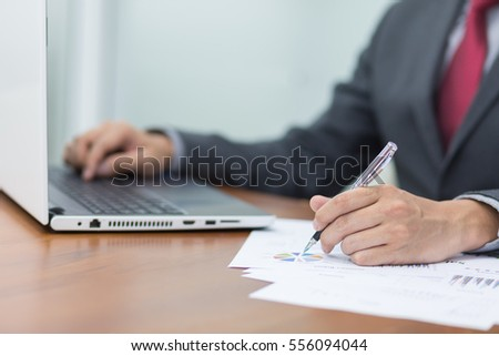 Business Concept;Businessman working with business document and laptop on the table